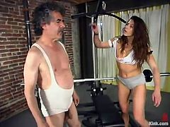 This luscious and juicy siren Kym Wilde is such a charming bitch! She gets naked and that dude is so fucking old for BDSM. Anyway seems like he is enjoying it!