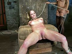 Isis Love ties a blonde girl up. Then the blonde babe also gets chocked with ropes and toyed with a vibrator. In addition she licks her mistress' pussy.