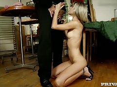 Provocative blonde Gina Gerson gives her head standing on her knees