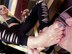 Amazing blond sex diva gives a hot footjob
