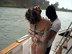 This sexy girl gets kidnapped by some dudes on the street in late hours. So they take her to the yacht and take her for a nice BDSM voyage!
