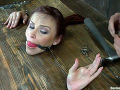 Bella's getting nailed, literally! She's immobilized in a bondage device and her fingers are locked on nails. To make things interesting for her a small fucking machine with a dildo strapped on is drilling her pussy from down to up. Is she terrified with what happens and will things get worse for her?