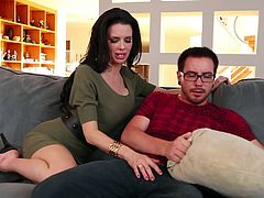 Dorky guy Dane is on Veronica's couch and the sight of such a sensual brunette milf makes his dick solid. The dude tries to hide his erection using that pillow but the mom has a lot of experience when it's about hard dicks and spots his erection! She immediately takes his penis out and begins to suck it!