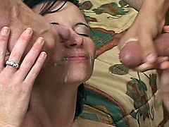 A short-haired brunette is getting naughty with two horny studs indoors. She gets face-fucked and then enjoys a long-lasting DP and gets her face splattered with cum.