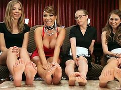 These horny chick show their sexy feet and lick them. Then these babes toy and feet finger each others pussies.