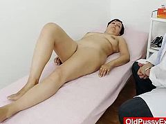 See how Jindraska humped her lady pussy with a huge rubber cock during the gyno test in nothing else than stunning nylon stockings and heels