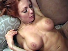 Nasty redhead MILF takes her clothes off and gets her pussy licked. After that she gives a blowjob and gets pounded on a sofa. In the end the guy cums on her face and tits.