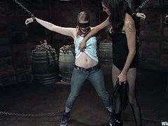 Naughty blonde chick gets undressed and tied up in a basement by the brunette mistress. She gets tortured with clothespins and then toyed with the vibrator.