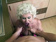 This old woman loves to fuck! She sucks her lover's meat stick with unrestrained passion. Then he fucks her loose twat in missionary position.