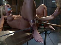 Maitresse Madeline and Mellanie Monroe are getting naughty in a basement in a hot BDSM scene. The dominatrix binds her slave and tortures her before pounding her holes with toys.