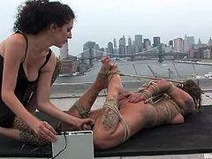 Horny chick with a gas mask on her face gets tied up and hit with electricity by her nasty mistress. Later on she also gets her vagina toyed.