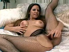This sexy and slutty babe gets naked and shows her curves. The fishnet stockings is what she loves wearing and babe palsy with a thick dildo!