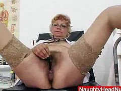A stunning blond mature, with a gorgeous body, pretty boobies and a tight pink vag does a self pussy checkup on herself in hot pink practical nurse uniform and stockings