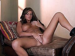Daisy Lynn does striptease before she plays with her wet hole