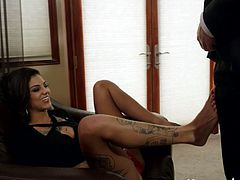 Zesty raven haired bitch Bonnie Rotten lets Bruce Venture suck and lick her soft smelly feet. She rubs her wet cunt in front of him and then starts sucking his massive cock.