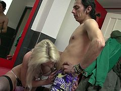 Superb blonde in black stockings receives deep penetration from a horny stud