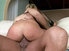 Fake tits is what makes this fucker cock stiff and ready for banging, she is sucking his fat sausage before she jump on it for a ride.