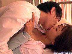 Saki Ninomyia has dismissed one of her students, because he is not feeling well. She goes to the sick bay, to check on him and realizes, he needs to be fucked. He grabs her and pulls her down onto the bed, and licks her boobs.