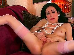 Glamorous black haired skinny Aiden Ashely with small natural boobies and long sexy legs in stockings and high heels has screaming orgasm while fingering wet shaved pussy on couch.