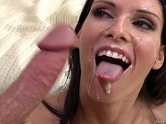 Brunette MILF with fake boobs takes her clothes off. Then she gives a blowjob to two dudes and gets fucked in a bedroom. After all both dudes cum on her happy face.