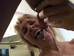 A lustful mature bitch is having fun with some guy in the kitchen. She favours the guy with a perfect deepthroat blowjob and then allows him to smash her juicy cunt doggy style.