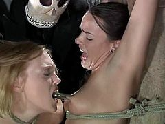 A blonde called Darling and her GF are getting their punishment for being so slutty. They get bound by some dude in the yard and then enjoy having clothespegs on their tits and tongues.