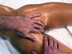 Well figured blonde porn star lies on a couch totally naked. Masseur applies much lubricant on her body smearing it all over. The guy has got talented hands so he brings ultimate pleasure.