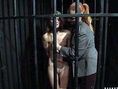 This naughty blondie must have done something very bad to be locked in the jail cell. The slut is helpless and completely at the mercy of her mistress. Check out this hot BDSM sex scene and get ready to cum!