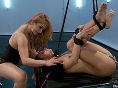 Sexy Riley gets tied up by Lea Lexis. She licks her mistress' toes and then gets her pussy wired. Then she also toyed with the dildo and a vibrator.