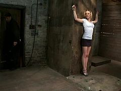 Slim blonde chick undresses and gets her tits tortured with claws. After that this tied up babe gets fingered and toyed.