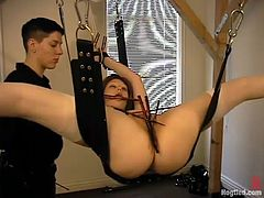 Sexy redhead girl gets tied up and whipped by the short-haired brunette chick. Then the submissive redhead girl gets wrapped in tape.