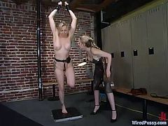 Gorgeous Adrianna has some fun with her friend in the gym. She takes her clothes off and gets her pussy stuffed with an electric dildo.