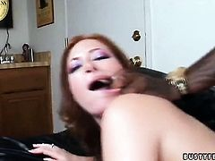 Redhead Ginger Blaze with gigantic melons has some time to stroke her twat