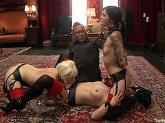 Krysta Kaos, Lilla Katt and their lesbian GF are having some good time together. They let two men tie them up and fulfil all the dudes' requests.