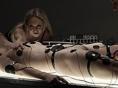 Electro sluts is pleased to present this outstanding act of sadism. Two juicy mistresses are having a lot of fun on that lusty slave.
