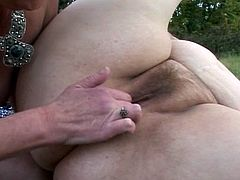 These two horny older women decide to engage in full blown lesbian sex in the grass on a blanket.Watch these busty and hairy grannies enjoy licking and fingering each other hairy cunts.