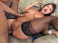 Salacious brown-haired woman wearing stockings gives a fantastic blowjob to some guy. The the dude slams the bitch's cunt and ass in all known positions and covers her face with his juice.