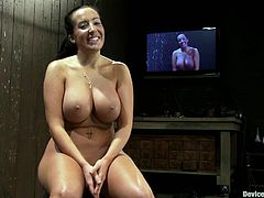 Bosomy brunette Richelle Ryan lets some man chain her into a pillory in a basement. Then she sits down on a fucking machine and gets her snatch rubbed to orgasm.