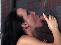 Katie St Ives is as sexy bodied brunette with juicy natural tits that sucks the sperm out of cock through a glory hole. This black haired babe shows it all as she sucks man off. She does it like a pro.