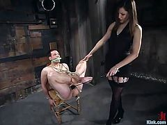 It's a femdom video featuring Bobbi Starr who has fun with the guy, playing with his dick, tying him up and fucking his ass with a strapon.