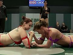 These chicks show great wrestling skills. One of the chicks loses a fight, so she gets her pussy licked and fingered.