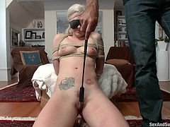 Cute blonde babe Bailey, is centered in the middle of her living room and blindfolded. Her cruel master takes his whip and spanks her pussy, and her inner thighs. She can handle the pain. He pushes her face to the ground and then, spanks her ass.