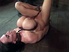 Amazing brunette chick with gigantic boobs gets hog tied. Later on she gets her vagina pleased with a vibrator. In addition she gets her huge boobs tortured with ropes.