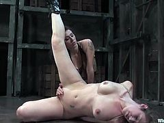 Jade Marxxx is having fun with Princess Donna Dolore in a basement. Donna binds and torments Jade and then attaches wires to her body and shows her fisting skills.