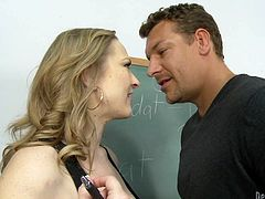 Provocative milf dreams of treasure he keeps in his pants. Her big boobs spill out off her bar and he can hardly cope with irresistible desire to fuck her right on the teacher's table.
