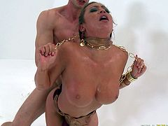 This chick knows the meaning of hard fuck. Horny stud pounds her ruthlessly in and out loosening up her once tight hole. Damn, her big tits drives me insane!