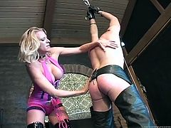 Curvaceous blonde chick in pink outfit spanks a tied up guy. Then she rubs her ass against his dick and sucks his massive dick.