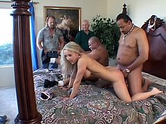 Get a load of this hardcore video where this slutty blonde takes on to massive black cocks in a threesome where her face's covered by cum as her husband watches.