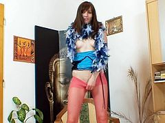 Sweetie loves stretching her red pantyhose during naughty solo fetish scene