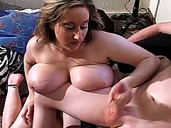 Chubby girl with huge boobs pleases a guy with her hands. Then she also gives him an unforgettable titjob.